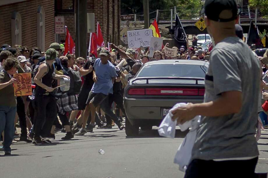 On Saturday, white supremacist groups clashed with hundreds of counter-protesters during the ''Unite The Right'' rally in Charlottesville, Va. Dozens were injured in skirmishes and many others after a white nationalist plowed his sports car into a throng of protesters. One counter-protester died after being struck by the vehicle. Photo: Michael Nigro /Pacific Press /TNS / Zuma Press