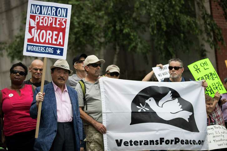 Activists rally against military action from the United Nations on Monday. The administration can't get its stories straight on North Korea.