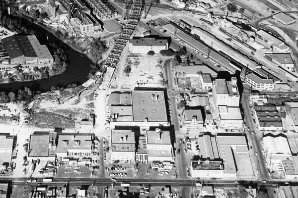 12/1956 - aerial view of construction on the Elysian Viaduct and Eastex Freeway. The Rusk School can be seen at center top with the Elysian Viaduct next to it.