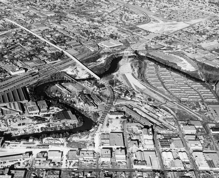 12/1956 - Aerial view of construction on the Elysian Viaduct and Eastex Freeway. Looking northeast over the intersection.