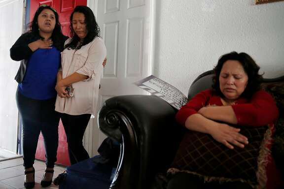 "Melin Sanchez, 21, center, is comforted by her friend Gabriela Ake, 23, as Ake emotionally addresses the press in the room while Maria Mendoza-Sanchez, right, holds a pillow and closes her eyes August 16, 2017 in the Sanchez home in Oakland, Calif. The family's application for a stay was denied. ""You have to stay strong, you cannot give up hope."" Ake said."