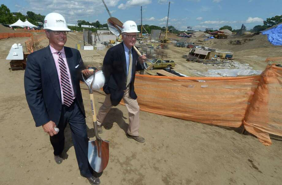 General Growth Properties Senior Director Doug Adams and GGP consultant Jim Adams exit the construction site following the official groundbreaking ceremony for The SoNo Collection mall on Wednesday in Norwalk. Photo: Erik Trautmann / Hearst Connecticut Media / Norwalk Hour