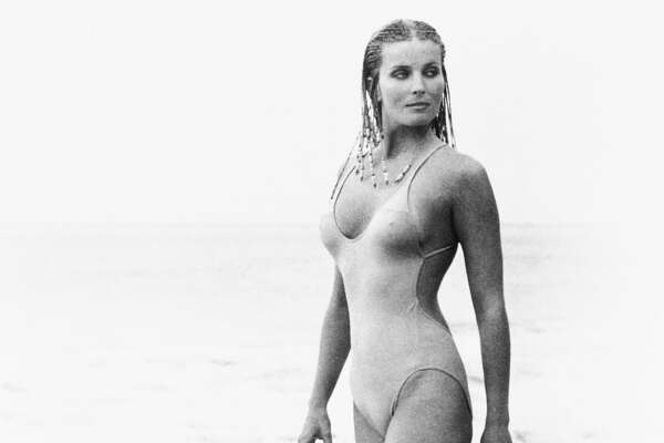 Actress Bo Derek, with her hair in cornrows, walks along the beach in swimwear as Samantha Taylor in the 1979 movie 10, directed by Blake Edwards.