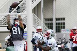 Houston Texans tight end Evan Baylis (81) reaches out to make a catch against New England Patriots free safety Duron Harmon (30) in the end zone during a joint practice between the Texans and the Patriots at training camp at The Greenbrier on Wednesday, Aug. 16,  2017, in White Sulphur Springs, W.Va.