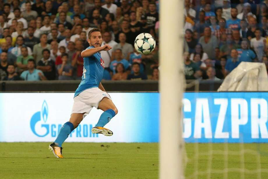 Napoli's Dries Mertens scores during a Champions League playoff round, first-leg match between Napoli and Nice at San Paolo stadium in Naples, Italy. Photo: Cesare Abbate, Associated Press