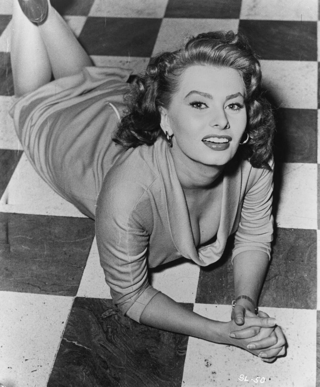 Actress Sophia Loren Lying on Floor.