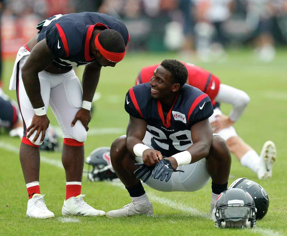 Houston Texans running backs Lamar Miller (26) and  Alfred Blue (28) walk while warming up during a joint practice between the Texans and the New England Patriots at training camp at The Greenbrier on Wednesday, Aug. 16,  2017, in White Sulphur Springs, W.Va. Photo: Brett Coomer, Houston Chronicle / © 2017 Houston Chronicle}