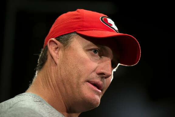 San Francisco 49ers General Manager John Lynch answers questions from reporters at a press conference following the team's joint workout with the Denver Broncos, on Wednesday, Aug. 16, 2017 in Santa Clara, Calif.