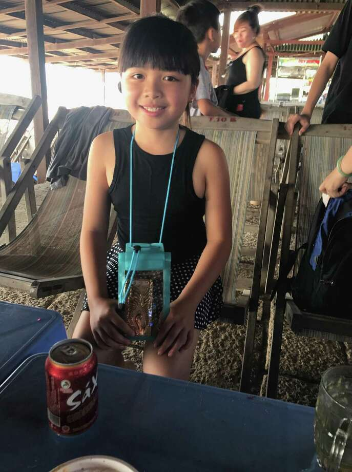 Linda Van, 10, died in a house fire at the Golden Wheel Mobile Home Park on Tuesday. Her best friend and a family member, both of whom were not identified, also died in the fire. Photo: Courtesy Thanh Van / Courtesy Thanh Van / Courtesy Thanh Van