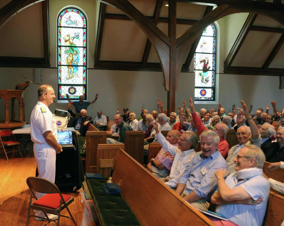 Former service members in the audience raise their hands as Rear Admiral John Weigold IV, Reserve Deputy Commander, U.S. Pacific Fleet, speaks during the Retired Men's Association weekly speaker series at First Presbyterian Church in Greenwich, Conn. Wednesday, Aug. 16, 2017. Admiral Wiegold spoke about the history and outlook of the Indo-Asia-Pacific region, including the rise of North Korea.