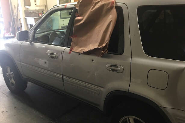 The victim's vehicle was struck by at least seven bullets. (Wash. State Patrol photo)