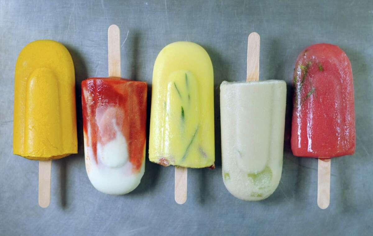 Popsicles, from left: Curried Sweet Potato, Tomato Goat Cheese, Buttermilk Cornbread, Almond Gazpacho, Rhubarb Lavender Sorrel.
