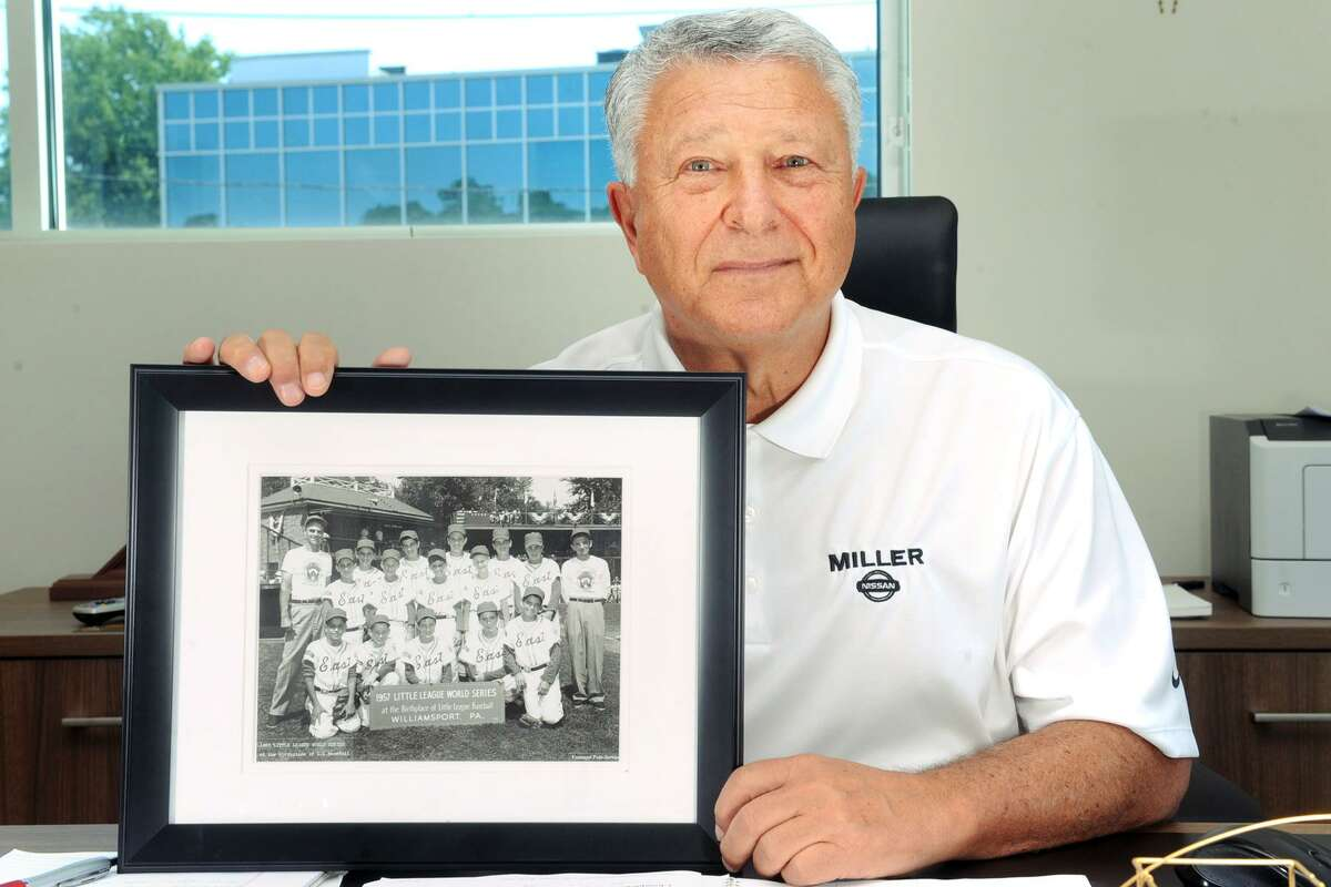 Paul Miller poses with a team photograph of the Bridgeport North End Little League team that he played on in 1957, seen here in his office at Miller Nissan in Fairfield, Conn. Aug. 16, 2017. The team played that year in the Little League World Series in Williamsport, Pa.