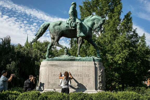 The statue of Robert E. Lee in Charlottesville, Va.  (Edu Bayer/The New York Times)
