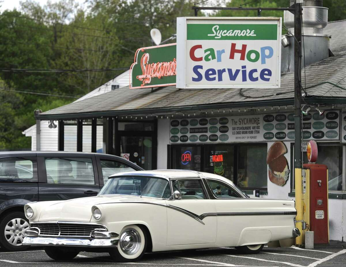 A custom 1956 Ford Crown Victoria sits in front of the Sycamore Drive-In in Bethel.