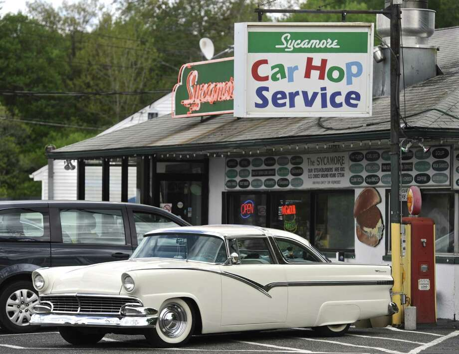 A custom 1956 Ford Crown Victoria sits in front of the Sycamore Drive-In in Bethel. Photo: H John Voorhees III / Hearst Connecticut Media / The News-Times