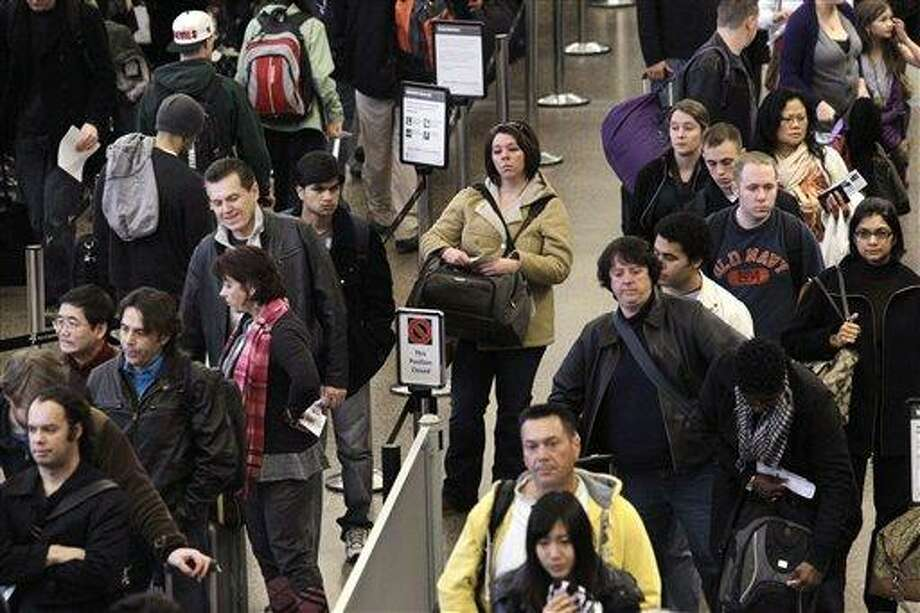 Long lines begin to develop as passengers wait to go through security at Seattle-Tacoma International Airport in Seattle in December 2010. Associated Press file photo Photo: AP / AP2010