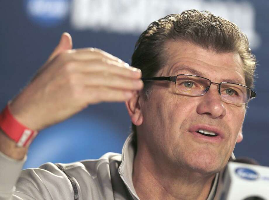 Connecticut head coach Geno Auriemma gestures during a news conference before practice for a regional championship game of the women's NCAA college basketball tournament in Bridgeport, Conn., Sunday March 31, 2013. Connecticut will play Kentucky Monday. (AP Photo/Charles Krupa) Photo: AP / AP