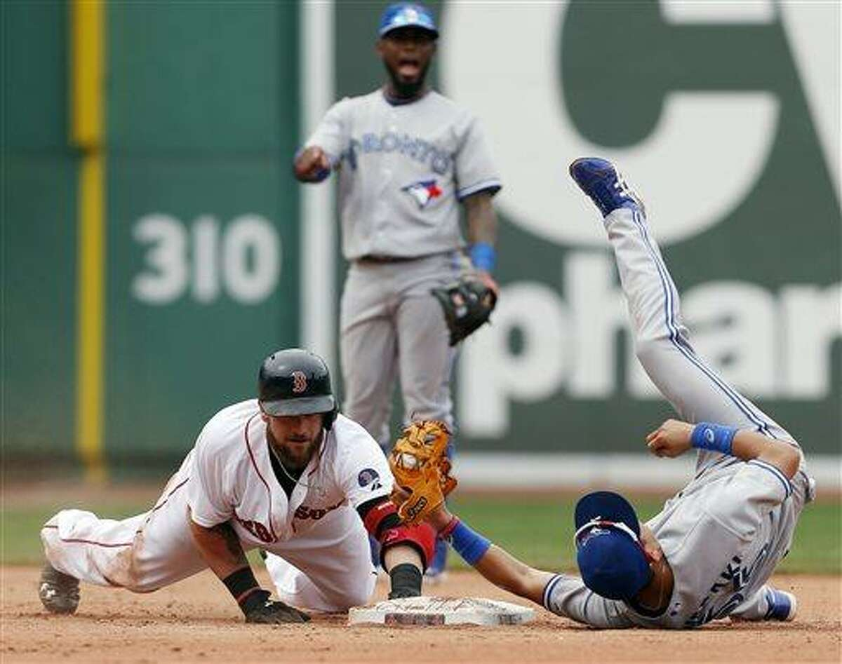 Boston Red Sox's Jonny Gomes, left, is safe at second base with a double as Toronto Blue Jays' Munenori Kawasaki, right, rolls on his back trying to make the tag in the fifth inning of a baseball game in Boston, Sunday, June 30, 2013. (AP Photo/Michael Dwyer)