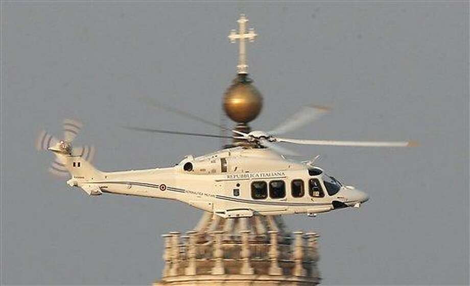 RETRANSMISSION OF SOB103 TO PROVIDE DIFFERENT CROP -- A helicopter with Pope Benedict XVI onboard leaves the Vatican in Rome, Thursday, Feb. 28, 2013. The 85-year-old German Pope Benedict is stepping down on Thursday evening, the first pope to do so in 600 years, after saying he no longer has the mental or physical strength to vigorously lead the world's 1.2 billion Catholics. (AP Photo/Michael Sohn) Photo: AP / AP