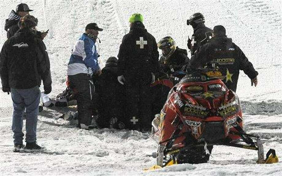 In this photo taken Jan. 24, 2013, emergency personnel tend to Caleb Moore after he crashed during the snowmoblie freestyle event at the Winter X Games in Aspen, Colo. Moore died Thursday. (AP Photo/The Colorado Springs Gazette, Christian Murdock) Photo: AP / The Colorado Springs Gazette