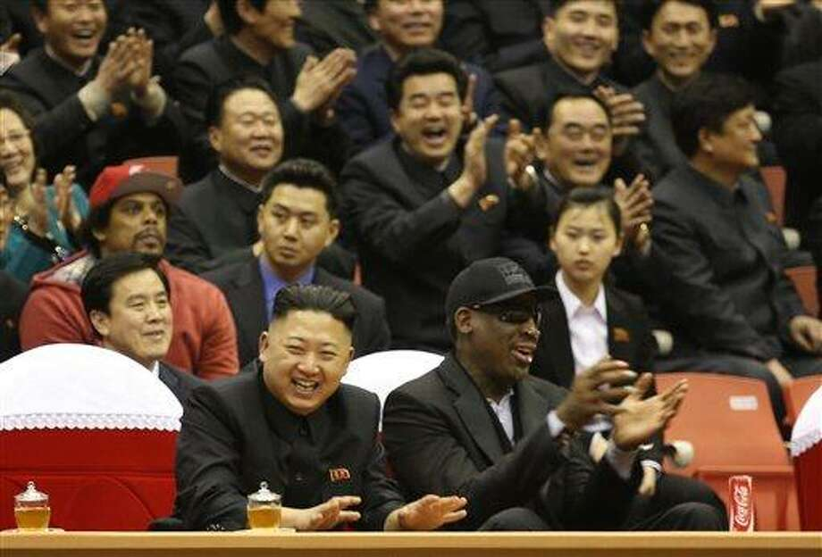 North Korean leader Kim Jong Un, left, and former NBA star Dennis Rodman watch North Korean and U.S. players in an exhibition basketball game at an arena in Pyongyang, North Korea, Thursday, Feb. 28, 2013. Rodman arrived in Pyongyang on Monday with three members of the Harlem Globetrotters basketball team to shoot an episode on North Korea for a new weekly HBO series. (AP Photo/VICE Media, Jason Mojica) Photo: AP / 2012 AP