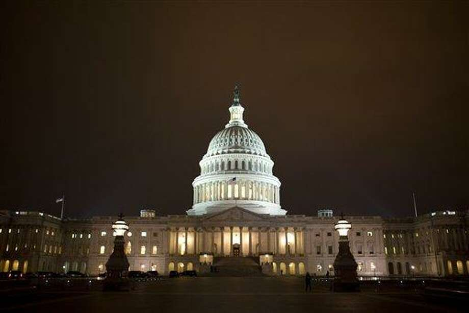 """The lights of the U.S. Capitol remain lit into the night as the House continues to work on the """"fiscal cliff"""" legislation proposed by the Senate, in Washington, on Tuesday, Jan. 1, 2013. (AP Photo/Jacquelyn Martin) Photo: AP / AP"""