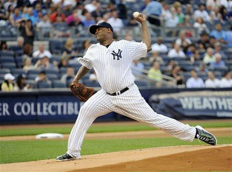 New York Yankees pitcher CC Sabathia delivers the ball to the Boston Red Sox during the first inning of a baseball game Friday, May 31, 2013, at Yankee Stadium in New York. (AP Photo/Bill Kostroun) Photo: AP / FR51951 AP