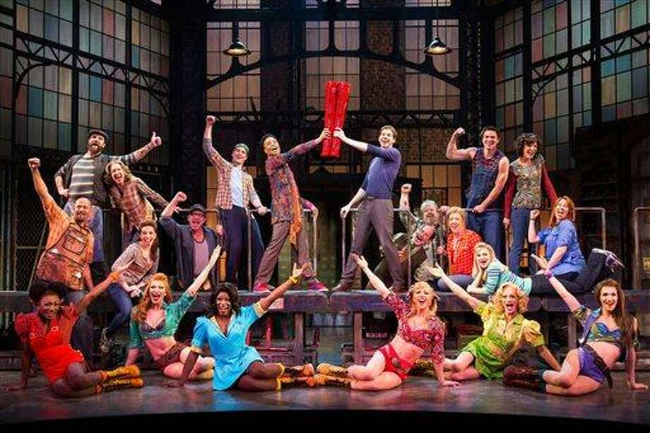 "This theater image released by The O+M Company shows the cast during a performance of the musical ""Kinky Boots.""  The Cyndi Lauper-scored ""Kinky Boots"" has earned a leading 13 Tony Award nominations, Tuesday, April 30, 2013. ""Kinky Boots"" is based on the 2005 British movie about a real-life shoe factory that struggles until it finds new life in fetish footwear.  The awards will be broadcast on CBS from Radio City Music Hall on June 9. (AP Photo/The O+M Company, Matthew Murphy) Photo: AP / The O+M Company"