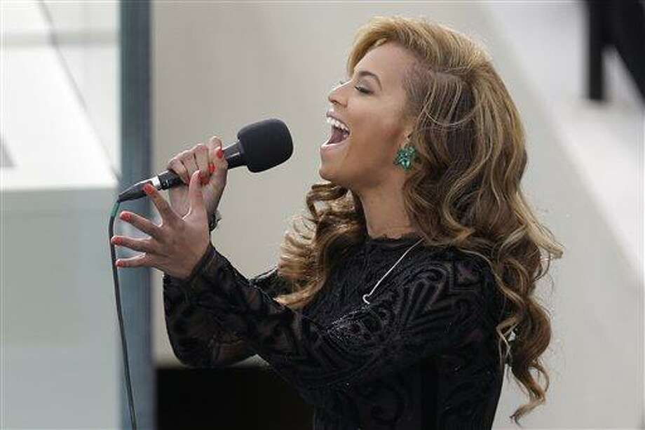 Beyonce sings the National Anthem at the ceremonial swearing-in for President Barack Obama at the U.S. Capitol during the 57th Presidential Inauguration in Washington, Monday, Jan. 21, 2013. (AP Photo/Evan Vucci) Photo: ASSOCIATED PRESS / AP2013
