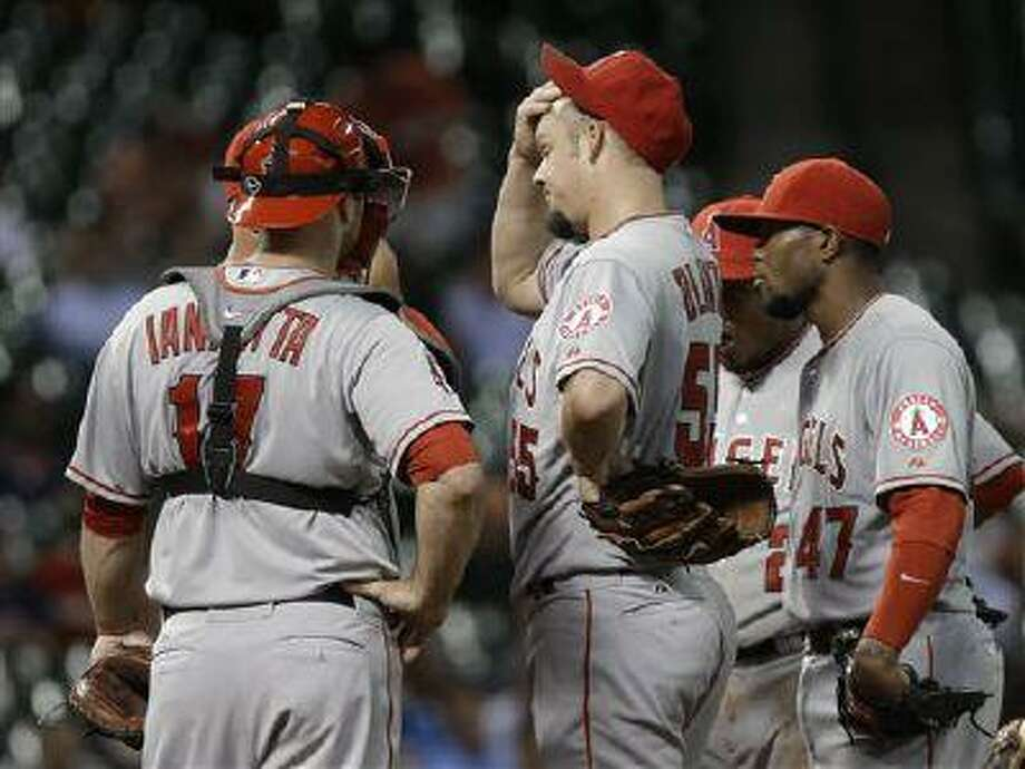 Los Angeles Angels starting pitcher Joe Blanton (55) gets a visit to the mound, May 8, 2013, in Houston. Photo: AP / AP