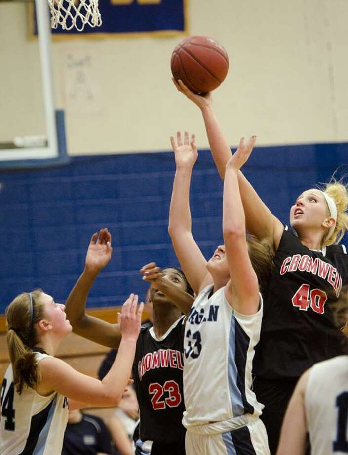 SPORTS-Cromwell'sJanelle Harrison and Lindsay Langenauer fight with Morgan's Jen Dawson and Kelsey Donaldson under the team's nt in 1st half action. Looking up fronm the floor is Morgan's Kelsey Dawson.   Melanie Stengel/Register