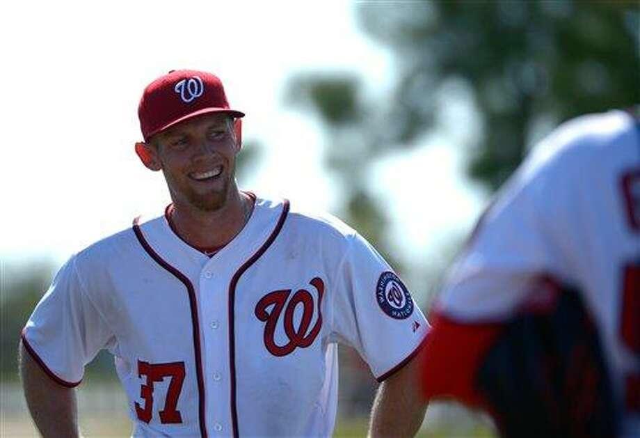 Washington Nationals pitcher Stephen Strasburg (37) smiles after throwing from the mound during batting practice at spring training baseball in Viera, Fla., Wednesday, Feb. 20, 2013.(AP Photo/Phelan M. Ebenhack) Photo: AP / FR121174 AP