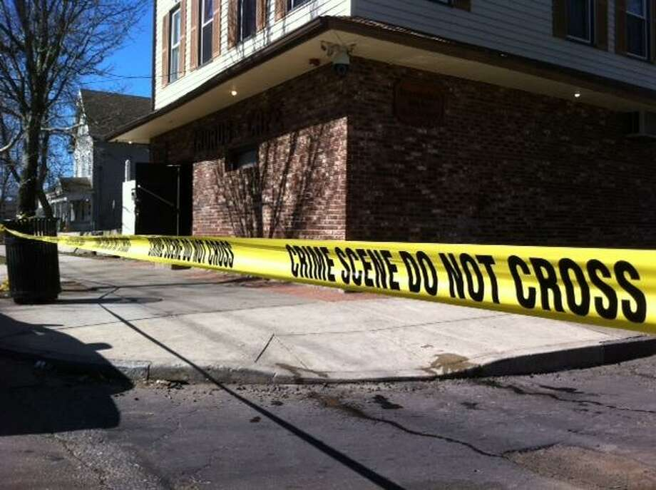 Police tape warns the public not to venture onto scene of homicide in New Haven. Peter Casolino/Register