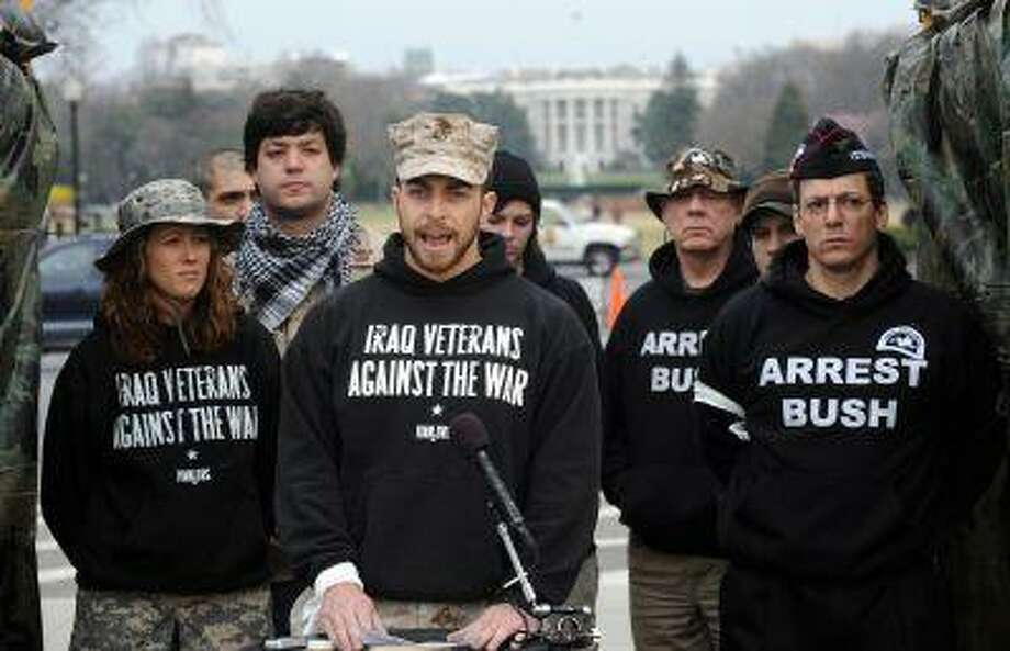 """Adam Kokesh(C), a Board Member of Iraq Veterans Against the War who served in Fallujah with a Marine Corps Civil Affairs team participates with other veterans in """"OPERATION NOT CHANGE"""", a tower-guard vigil across from the White House on March 19, 2009 in Washington, DC. Photo: AFP/Getty Images / 2009 AFP"""