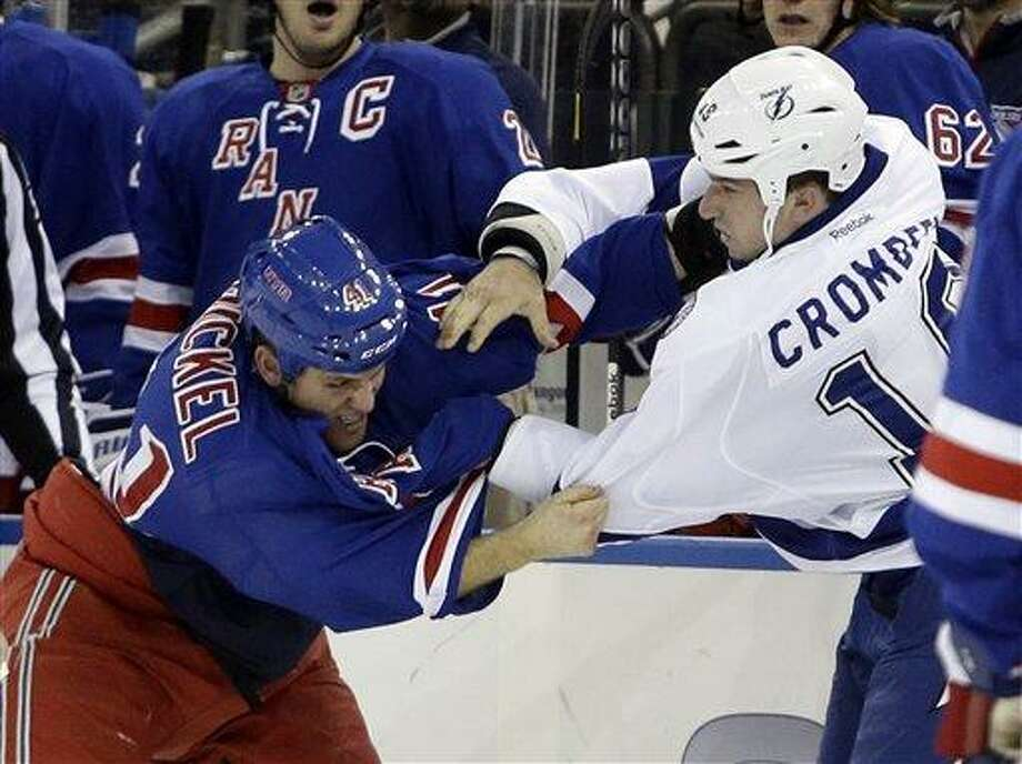 Tampa Bay Lightning's B.J. Crombeen, right, and New York Rangers' Stu Bickel, left, fight during the first period of an NHL hockey game on Thursday, Feb. 28, 2013, in New York. (AP Photo/Frank Franklin II) Photo: AP / AP