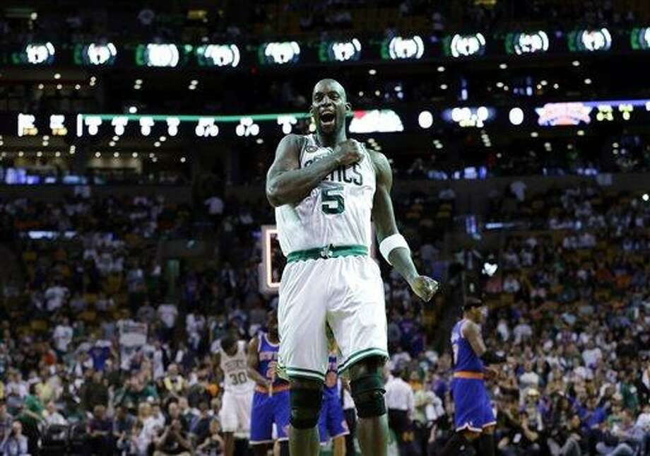 Boston Celtics center Kevin Garnett (5) pounds his chest just before tap-off against the New York Knicks in Game 4 of a first round NBA basketball playoff series in Boston, Sunday, April 28, 2013. (AP Photo/Elise Amendola) Photo: AP / AP