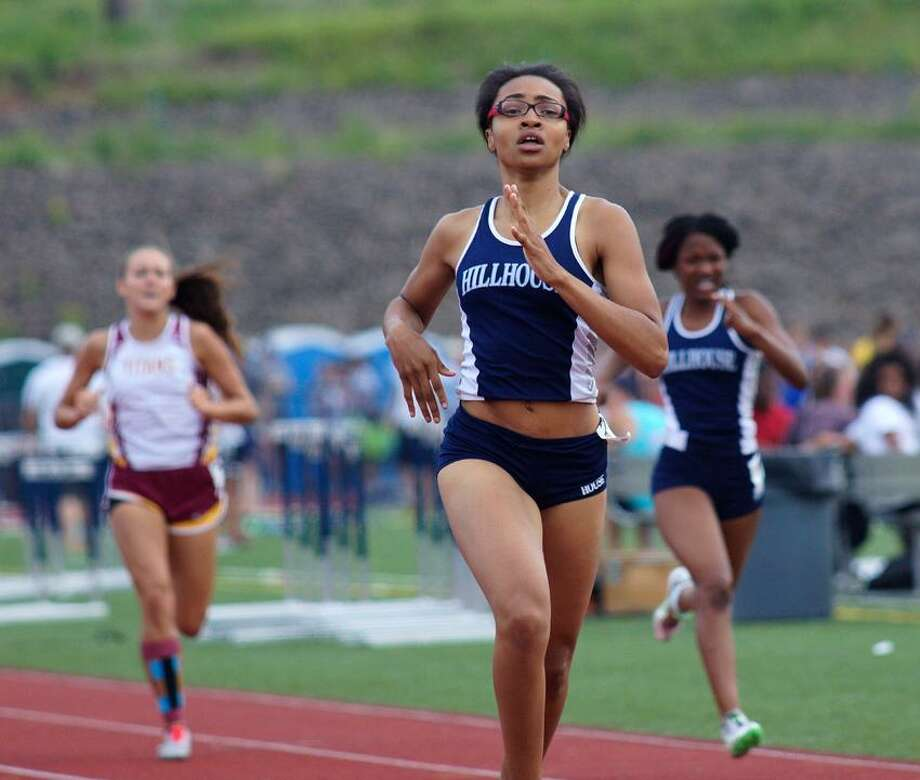 """Middletown--Hillhouse's Jayvona McDaniel on her way to a win in the third heat of the 400-meter during the Class MM track meet at Middletown High School.   Photo-Peter Casolino/Register <a href=""""mailto:pcasolino@newhavenregister.com"""">pcasolino@newhavenregister.com</a>"""