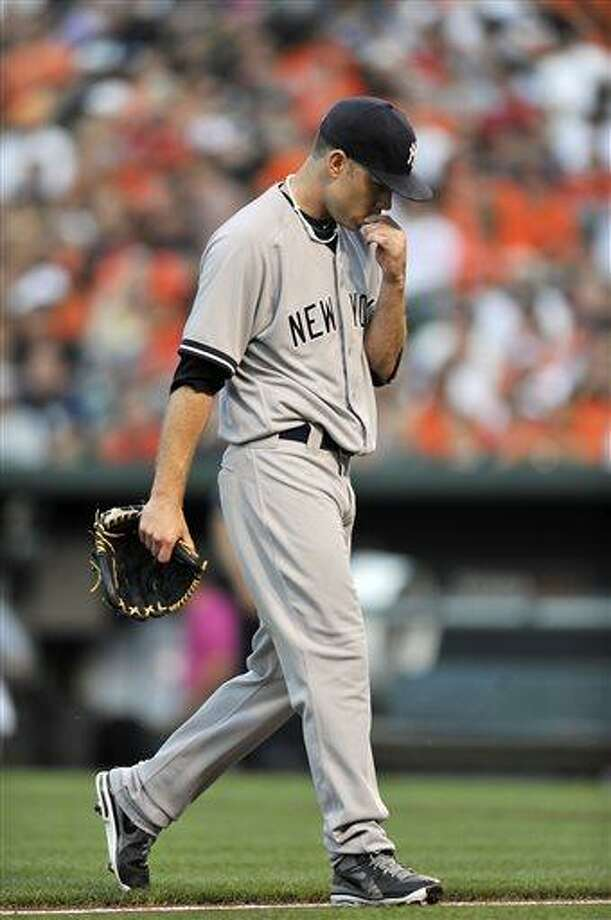 New York Yankees pitcher Kevin Phelps walks to the dugout after giving up four runs to the Baltimore Orioles in the first inning of a baseball game, Saturday, June 29, 2013, in Baltimore. (AP Photo/Gail Burton) Photo: AP / FR4095 AP