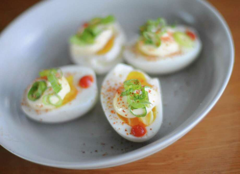 Paramour and chef Jason Dady have partnered to create a menu for the popular rooftop bar including these deviled eggs. Photo: Paul Stephen / San Antonio Express-News