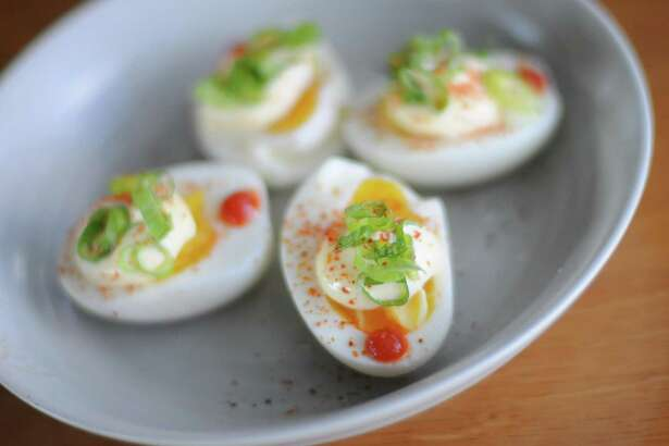 Paramour and chef Jason Dady have partnered to create a menu for the popular rooftop bar including these deviled eggs.