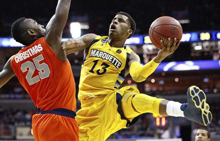 Marquette guard Trent Lockett (13) shoots past Syracuse forward Rakeem Christmas (25) during the second half of the East Regional final in the NCAA men's college basketball tournament, Saturday, March 30, 2013, in Washington. (AP Photo/Mark Tenally) Photo: AP / AP2013