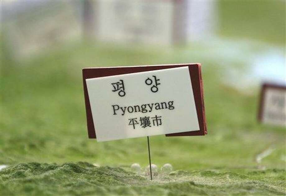 """A sign indicating the location of North Korea's capital Pyongyang is pinned on a giant relief map of Korean Peninsula as part of exhibition at the unification observation post near the border village of Panmunjom, that has separated the two Koreas since the Korean War, in Paju, north of Seoul, South Korea, Saturday, March 30, 2013. North Korea issued its latest belligerent threat Saturday, saying it has entered """"a state of war"""" with South Korea a day after its young leader threatened the United States because two American B-2 bombers flew a training mission in South Korea. (AP Photo/Lee Jin-man) Photo: AP / AP"""