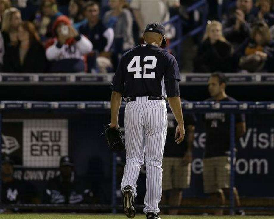 New York Yankees relief pitcher Mariano Rivera (42) leaves the field after pitching in a spring training baseball game in Tampa, Fla., Thursday, March 21, 2013.  (AP Photo/Kathy Willens) Photo: AP / AP