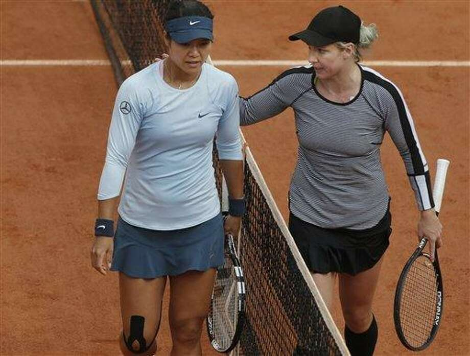 Bethanie Mattek-Sands of the U.S. pats 2011 Roland Garros winner Li Na of China on her shoulder after defeating Li Na in their second round match at the French Open tennis tournament, at Roland Garros stadium in Paris, Thursday, May 30, 2013. Mattek-Sands won in three sets 6-1, 5-7, 6-4. (AP Photo/Michel Spingler) Photo: AP / AP