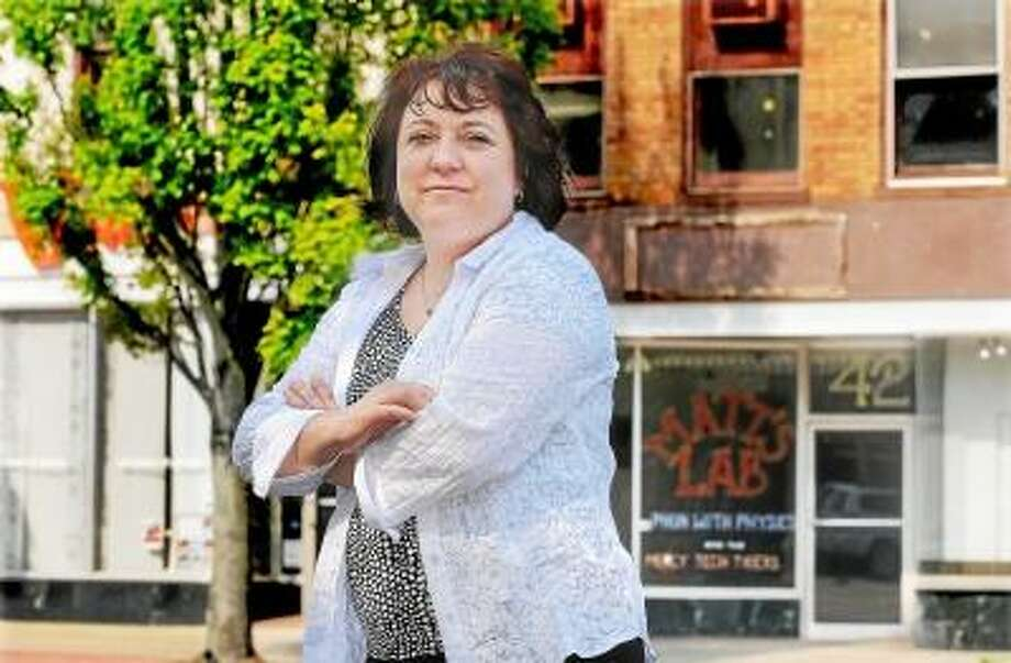 Catherine Avalone/The Middletown Press Diane Gervais' family owns two buildings at 420 and 424 Main Street located across the street from the long-established shop, Amatoâ??s Toy and Hobby. The model buildings are three stories high and are the only surviving examples of late 19th century commercial building in the townâ??s central business district and have been selected for The Come Home to Downtown pilot program, which is a mixed-used real estate planning program created in partnership with Connecticut Housing Finance Authority. / TheMiddletownPress