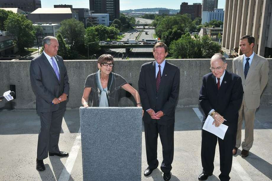 In this file photo: Mayor John DeStefano, Jr., Congresswoman Rosa DeLauro, U.S. Sen. Richard Blumenthal, State Sen. Martin Looney and developer Carter Winstanley announce the Downtown Crossing project. The press conference was on top of the Air Rights Garage.  Peter Casolino/New Haven Register 8/07/12
