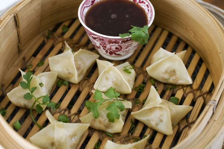 Matthew Mead/Associated Press photo: Vegetarian Steamed Dumplings With Sweet-and-Sour Sauce Photo: AP / FR170582