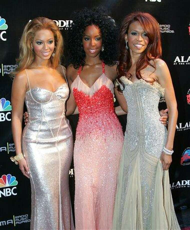 FILE - This Oct. 25, 2004 file photo shows members of Destiny's Child, from left, Beyonce Knowles, Kelly Rowland and Michelle Williams at the Radio Music Awards in Las Vegas. The singer-actress _ one third of Destiny's Child alongside Beyonce and Kelly Rowland _ said that in the past few months she has emerged from years of suffering from moderate depression. Her dark cloud lifted thanks to exercise, therapy and positive thinking.  (AP Photo/Eric Jamison, file) Photo: AP / A-JAMISON