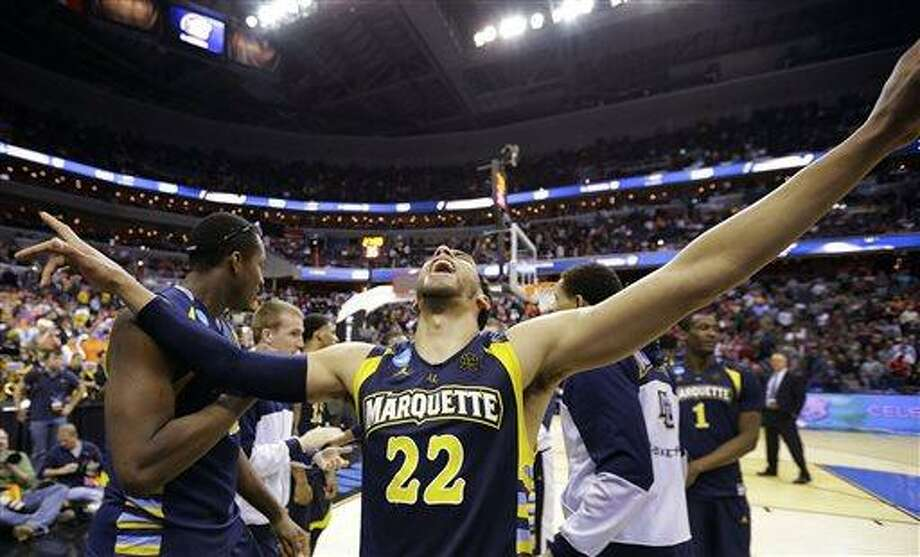 Marquette guard Trent Lockett (22) celebrates their 71-61 win over Miami in an East Regional semifinal in the NCAA college basketball tournament, Thursday, March 28, 2013, in Washington. (AP Photo/Alex Brandon) Photo: AP / AP
